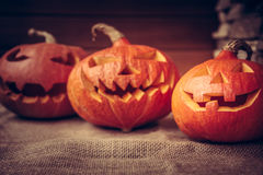 Halloween pumpkins family on rustic background Stock Photo