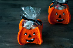 Halloween pumpkins filled with candy Royalty Free Stock Photos