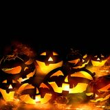 Halloween pumpkins and fire flames black background Stock Photo