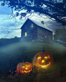 Halloween pumpkins in front of Spooky house Stock Photography