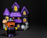 Halloween pumpkins ghost house on black background. Halloween pumpkins ghost house doll on black background Royalty Free Stock Photo