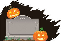 Halloween pumpkins on the grave Stock Images
