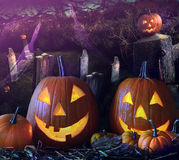 Halloween pumpkins in the grave yard Royalty Free Stock Photo