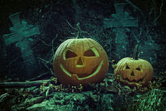 Halloween pumpkins in graveyard at night. Halloween pumpkins with tombstones in graveyard at night stock photography