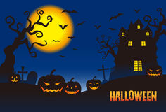 Halloween pumpkins and a haunted mansion in full moon night Royalty Free Stock Images