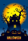 Halloween, pumpkins and a haunted mansion in full moon night Royalty Free Stock Image