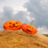 Halloween pumpkins on hay ougdoors Stock Photography