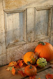 Halloween pumpkins and leaves. Pumpkins, broom and gourds at the door ready for halloween royalty free stock photos