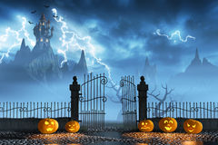 Halloween pumpkins next to a gate of a spooky castle Stock Photo