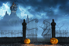 Halloween pumpkins next to a gate of a spooky castle Royalty Free Stock Image