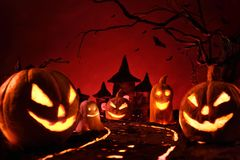 Halloween pumpkins of nightly spooky forest and Castle Stock Photos