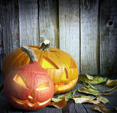 Halloween pumpkins on old grunge boards Royalty Free Stock Photo