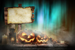 Halloween Pumpkins on old wooden table Stock Images