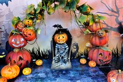 Halloween pumpkins prisoner scene background. Pumpkin prisoners in the coffin for Halloween Royalty Free Stock Images