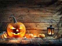 Halloween Pumpkins In Rustic Background royalty free stock images