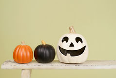 Halloween Pumpkins on Rustic Wood Bench Royalty Free Stock Images
