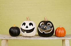 Halloween Pumpkins on Rustic Wood Bench Royalty Free Stock Image