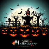 Halloween Pumpkins with Scarecrow in front of Full Moon Stock Image