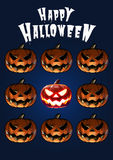 Halloween pumpkins in scary expression tile on dark blue backgro Stock Image