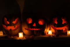 Halloween pumpkins with scary face and burning candle Royalty Free Stock Photos