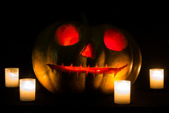 Halloween pumpkins with scary face and burning candle Stock Photo
