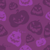 Halloween pumpkins seamless pattern. Violet vector illustration in cartoon style for holiday poster, banner, brochure, invitation Royalty Free Stock Photography