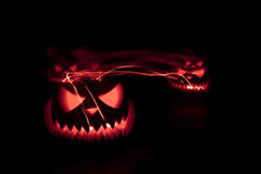 Halloween pumpkins shiny inside on black Royalty Free Stock Images