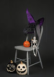 Halloween Pumpkins, Skeleton and Witch Hat Stock Photo