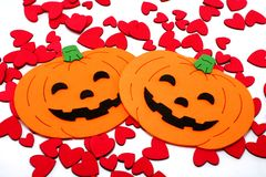 Halloween Pumpkins with small hearts royalty free stock photography