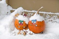 Halloween pumpkins in snow Royalty Free Stock Image