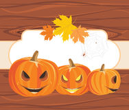 Halloween pumpkins and spiders on the wooden background Royalty Free Stock Photo