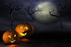 Halloween pumpkins in a spooky forest at night Stock Image