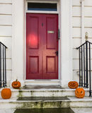 Halloween pumpkins on steps of a house in Whitby during Goth Festival weekend. Royalty Free Stock Images