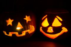 Halloween pumpkins. Two halloween pumpkins decorations shining Stock Photography