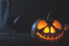 Halloween pumpkins at wood background. Carved scary faces of pumpkin. Royalty Free Stock Images