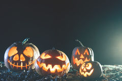 Halloween pumpkins at wood background. Royalty Free Stock Photo