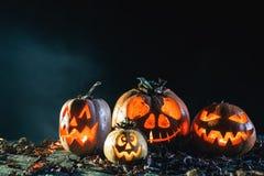 Halloween pumpkins at wood background. Royalty Free Stock Photos