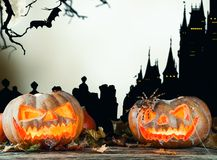 Halloween pumpkins on wood with dark background Royalty Free Stock Photos