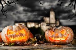 Halloween pumpkins on wood with dark background Stock Photos