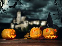 Halloween pumpkins on wood with dark background Royalty Free Stock Images