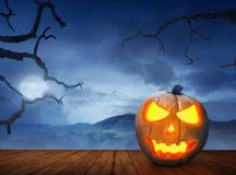 Halloween pumpkins on wood floor in a scary hill Royalty Free Stock Photography