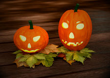 Halloween pumpkins, wooden background with dry Stock Images