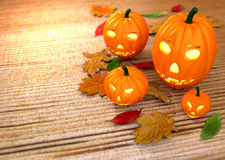 Halloween pumpkins, wooden background with dry. Leaves - 3D render royalty free illustration
