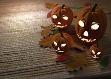 Halloween pumpkins, wooden background with dry Stock Image