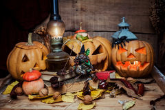 Halloween pumpkins on wooden background Royalty Free Stock Images