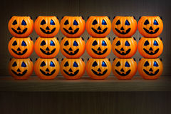 Halloween pumpkins on wooden shelf. Background vector illustration