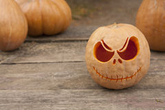 Halloween pumpkins on a wooden table Royalty Free Stock Image