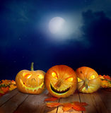 halloween pumpkins on a wooden table Royalty Free Stock Images