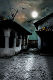 Halloween pumpkins in the yard of an old house at night in the b stock illustration