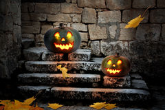 Halloween pumpkins in the yard of an old house at night Royalty Free Stock Photography